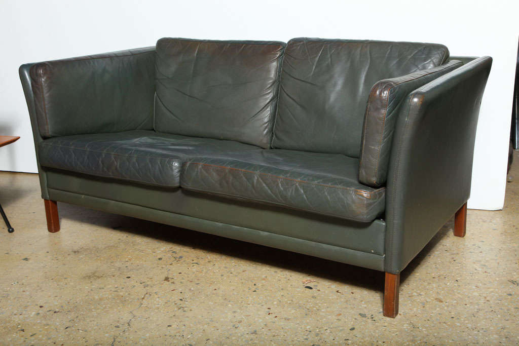 Graceful 6 Cushion Slate Green Leather Love Seat on wooden legs