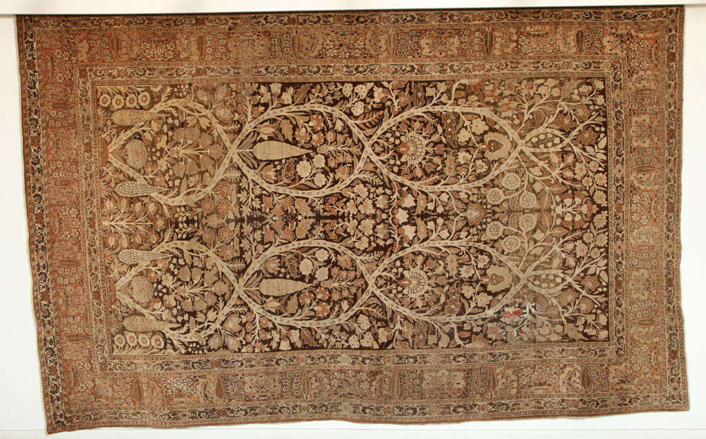 This Persian Haji Jalili Tabriz carpet created circa 1870 consists of a cotton warp and weft, hand-knotted wool pile and organic vegetal dyes. It is an exceptionally Fine example from the master artist and weaver Haji Jalili, and was crafted using