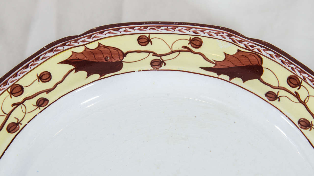 A set of ten early 19th century creamware dishes with a beautiful border decorated with brown oak leaves and acorns painted on a soft yellow ground.  Patterns like these date from the last quarter of the eighteenth century into the first quarter of