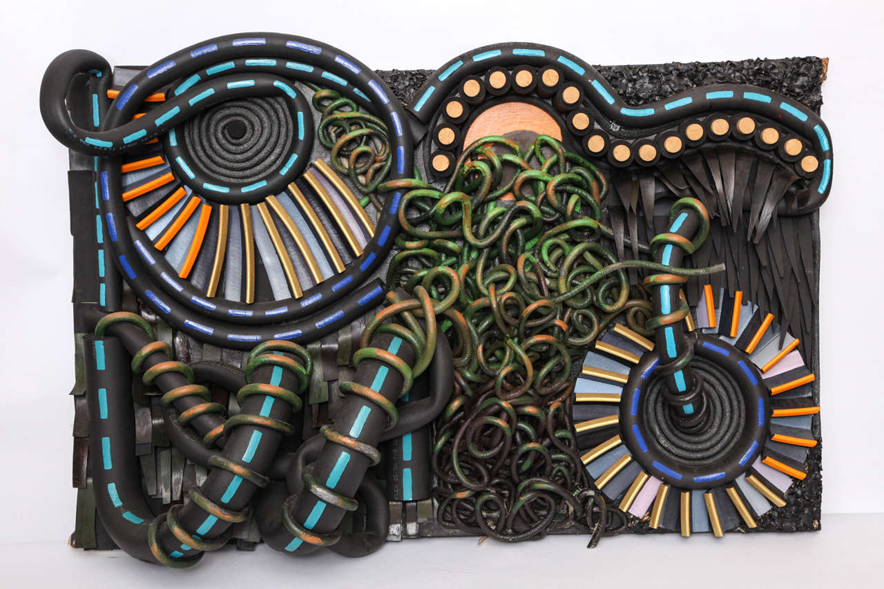 An assemblage of mixed-media on wood by Alfredo Eguiguren.