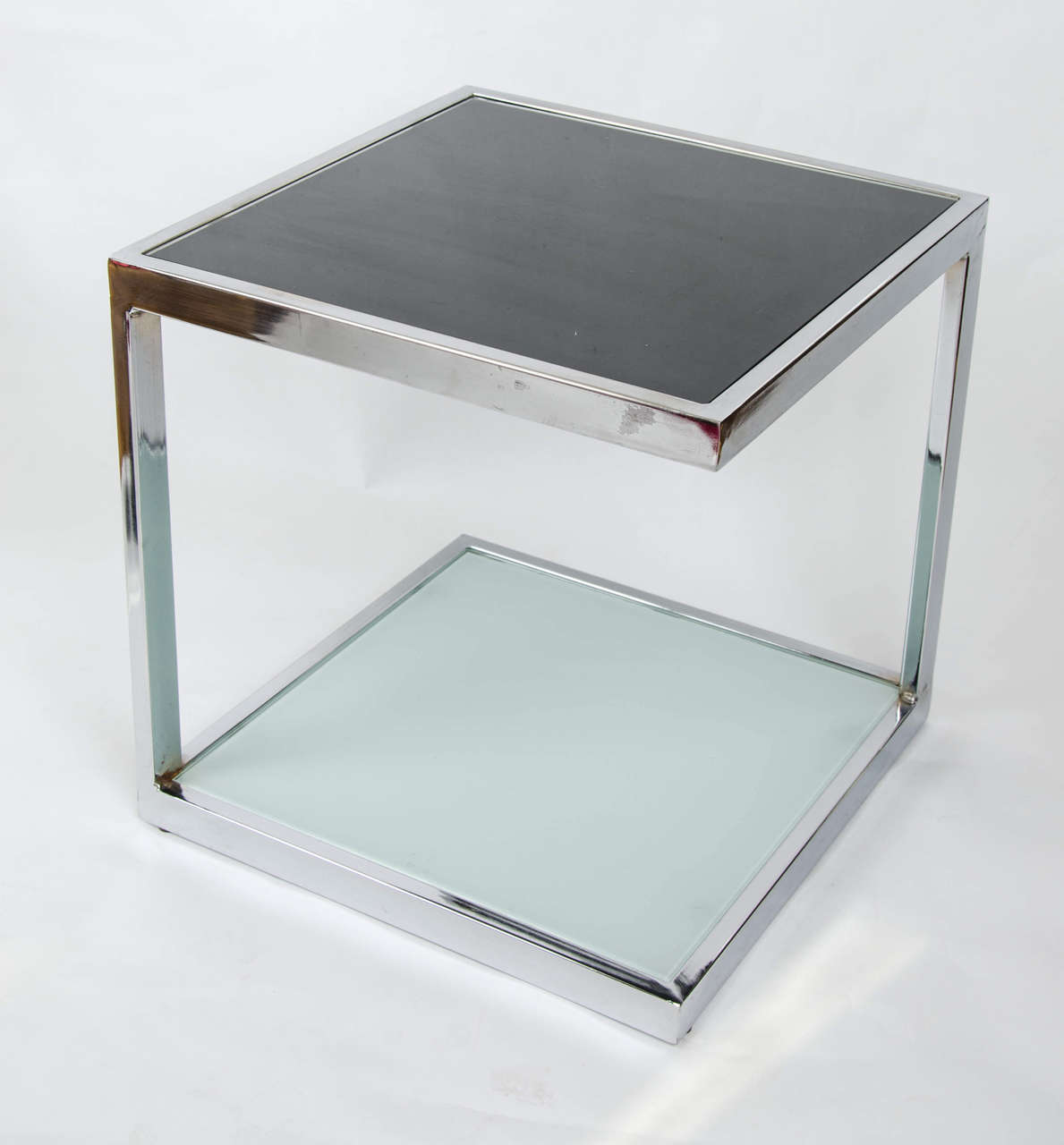 Elegant minimalism. Two pairs of sturdy mid-century French cube side tables in chrome and glass.  Price quoted based on a pair. Four available.