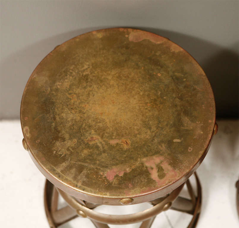 Pair of brass side tables or stools.  Priced individually at $365.