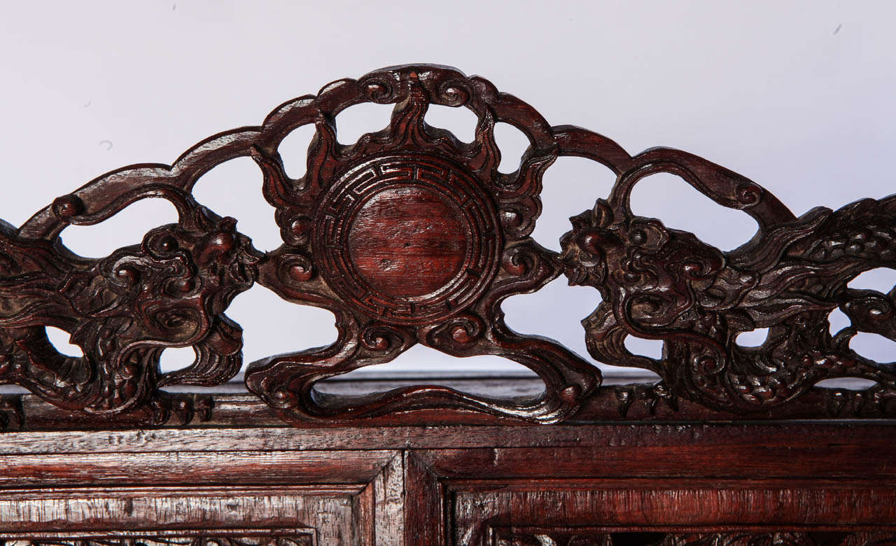 19th Century A Chinese  small openwork wood cabinet depicting Dragons For Sale