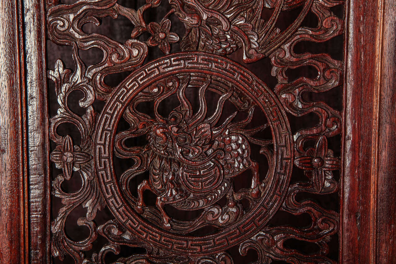 A Chinese  small openwork wood cabinet depicting Dragons For Sale 1