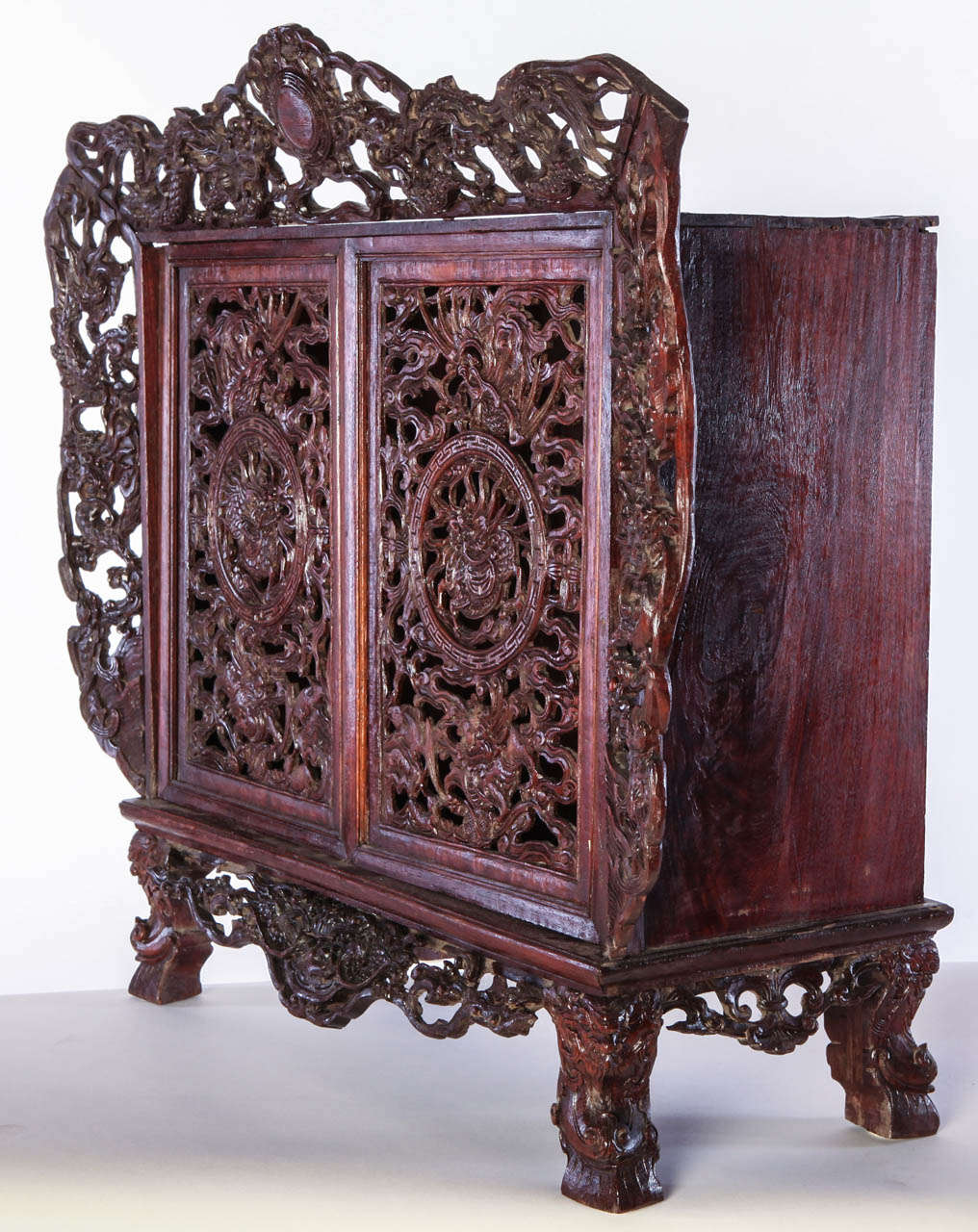 A Chinese  small openwork wood cabinet depicting Dragons For Sale 4