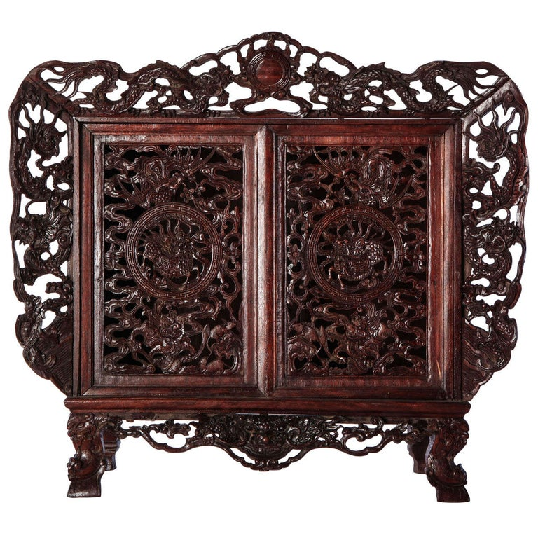 A Chinese  small openwork wood cabinet depicting Dragons For Sale