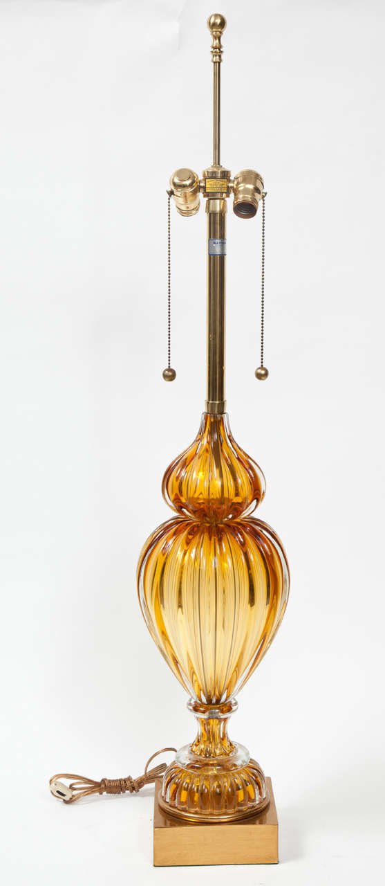 A pair of Murano glass lamps made by Marbro in a beautiful cognac color. The lamps have original Marbro label and brass base.