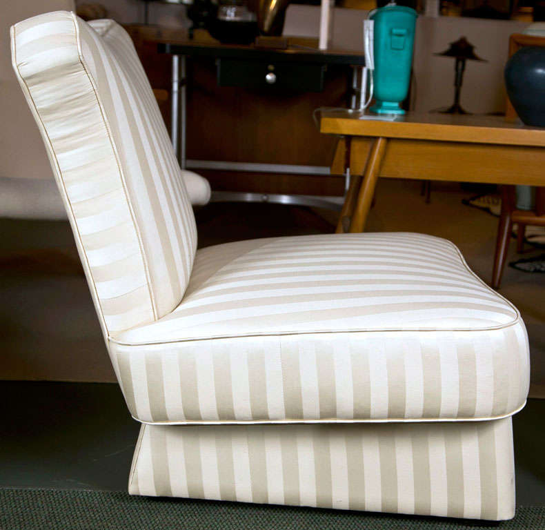 20th Century Pair of Slipper Chairs in the style of James Mont. For Sale