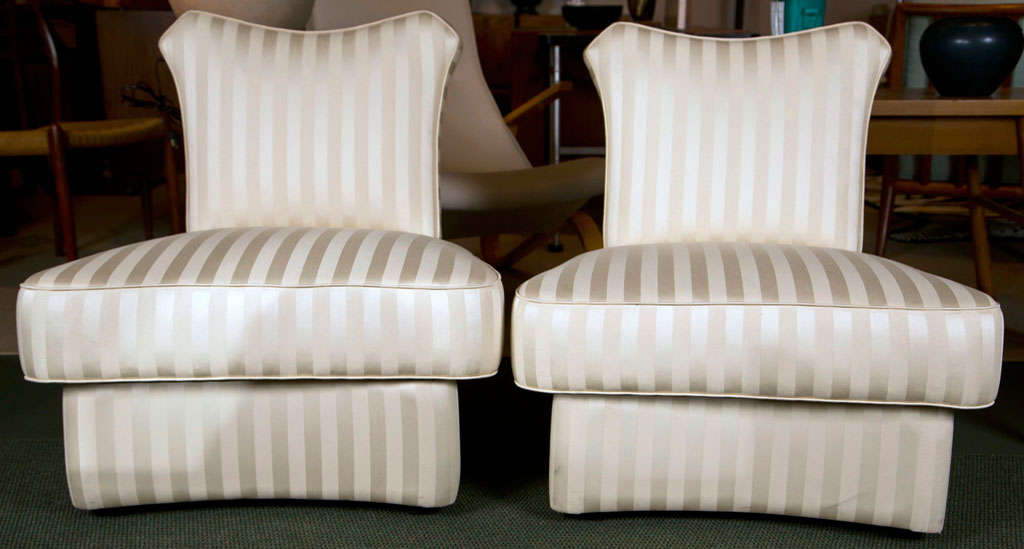 A pair of slipper chairs in the style of James Mont.