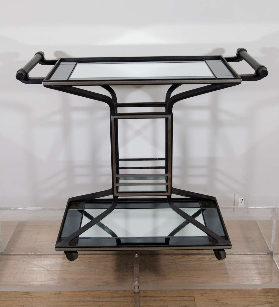 Three tiered  iron bar, beautifully detailed in industrial art deco style. Fitted with new two tone mirror, the frame in its original finish.
