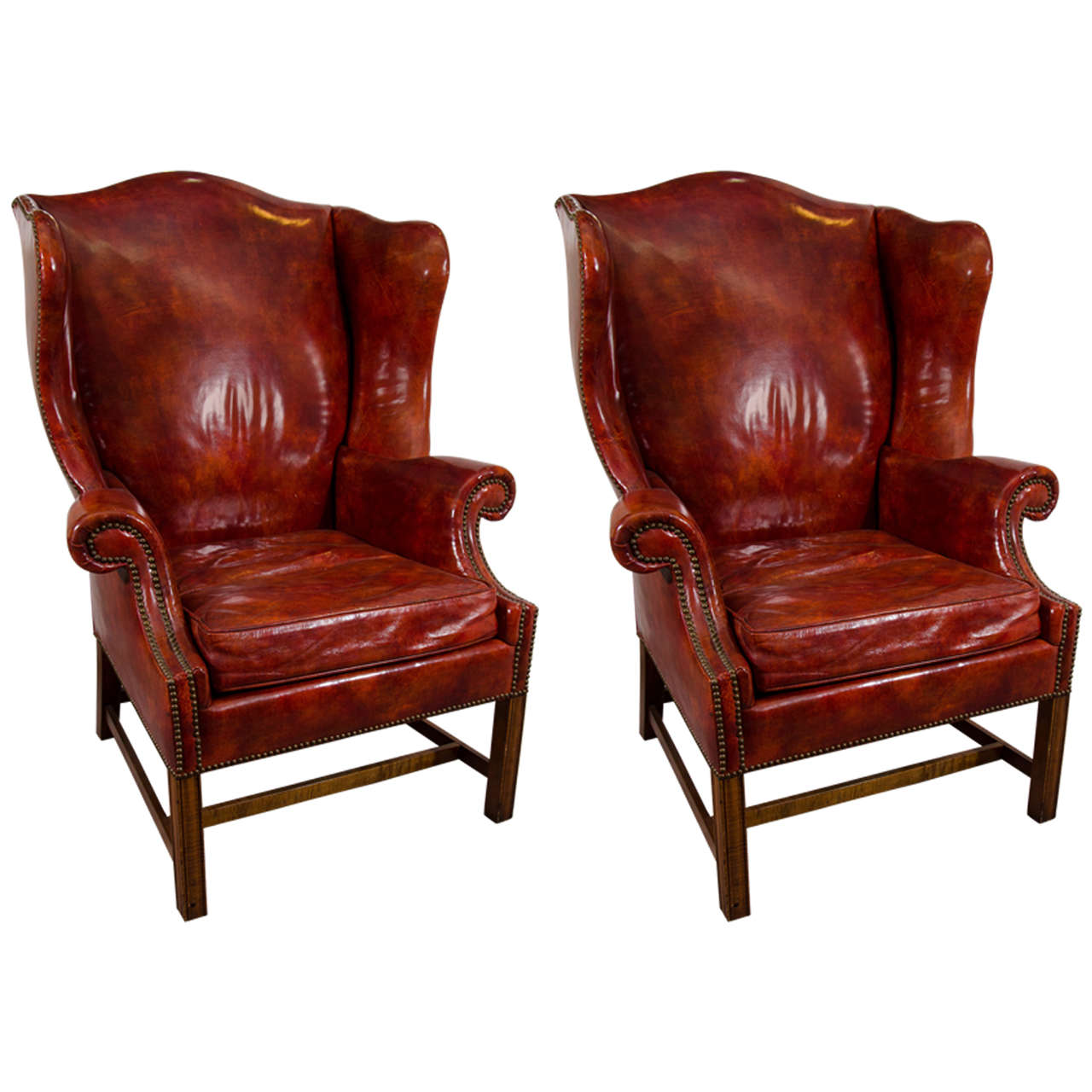 Beau Midcentury Pair Of Burgundy Leather Wing Chairs By Baker For Sale