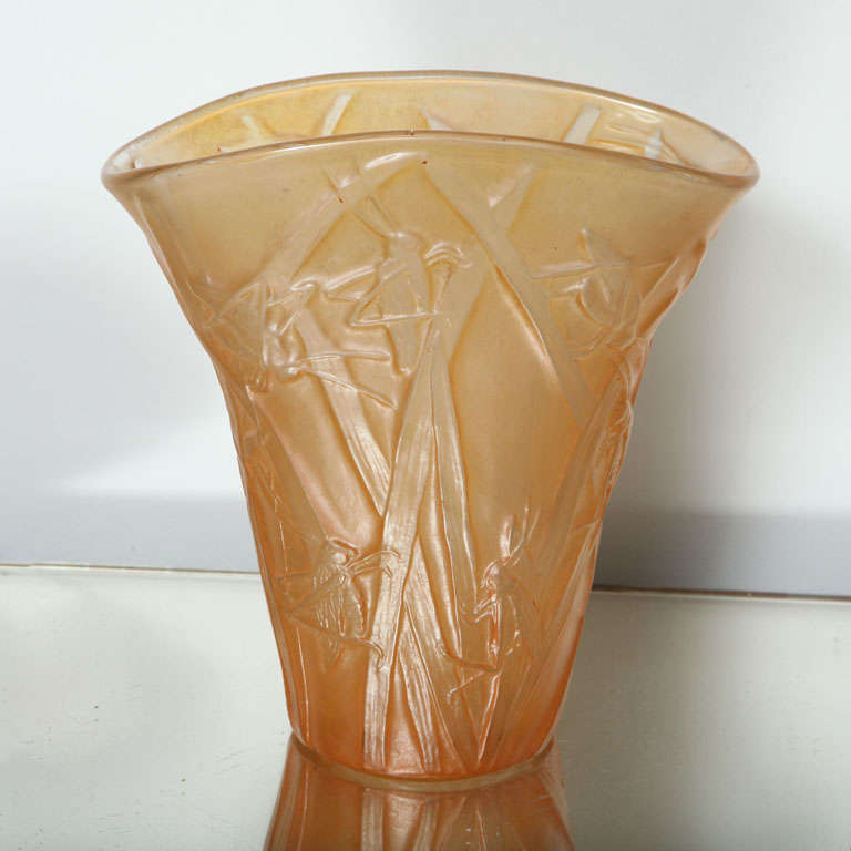 A great amber Phoenix Glass vase depicting grasshoppers on reeds.