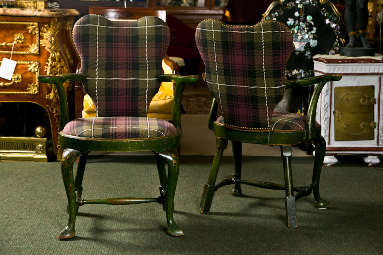A wonderful set of four George II flaring chinoiserie arm chairs in beautiful upholstery.