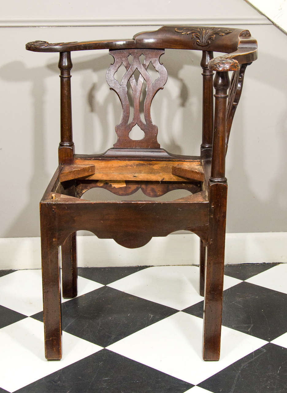 18th century Irish corner chair with pierced back splat and carved back.