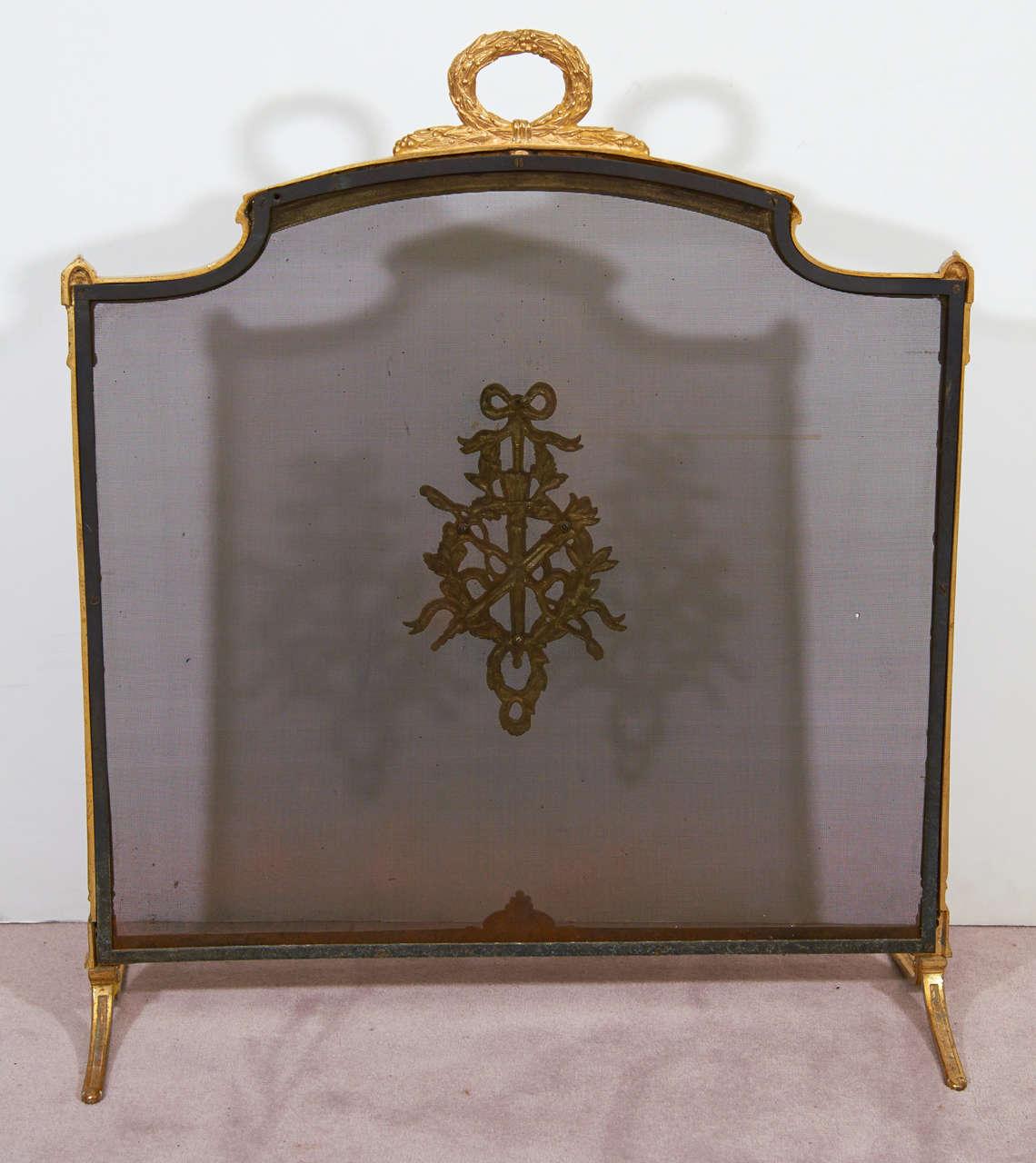 antique dore bronze screen w ribbon detail at
