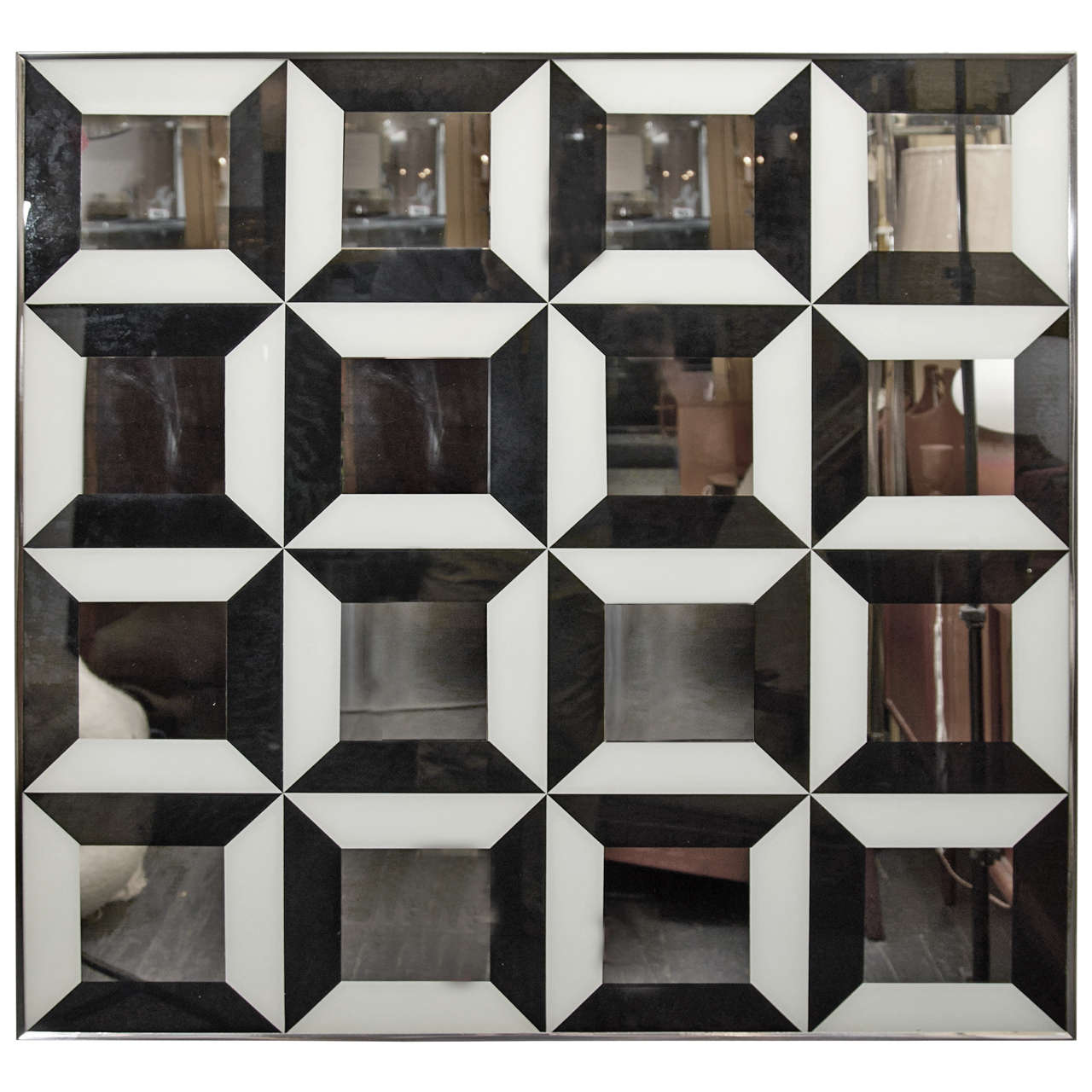 Mod, geometric op art mirror with a grid of black and white reverse painted graphics. Can be mounted square or diagonally. Please contact for location. Offered by Las Venus by Kenneth Clark, New York City.