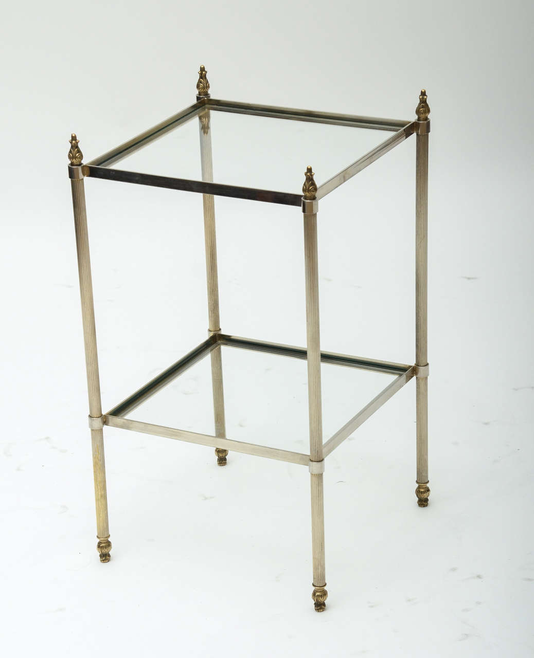 A pair of French 1950s Baguès style brass and glass side tables with acorn finials.