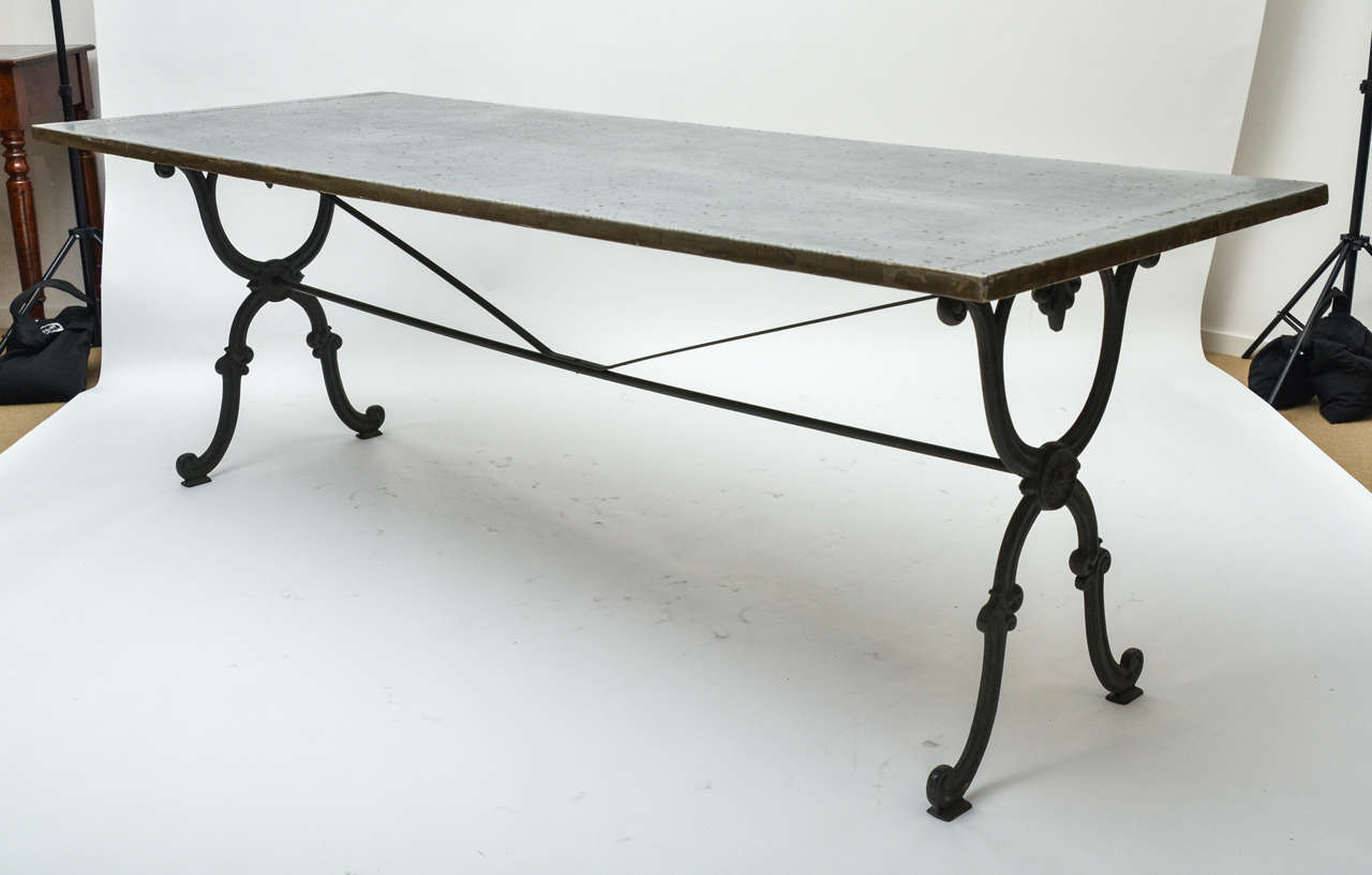 A 19th Century Cast Iron Base Writing Dining Table With Stretcher From