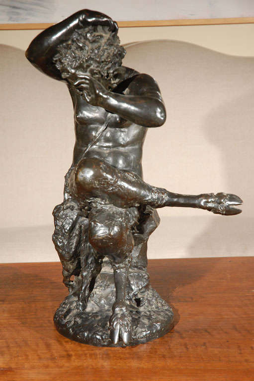 Cast bronze sculpture of a yawning Satyr  after the original by important French sculptor, Claude Michel Clodion (1738-1814).  According to artnet:  Claude Michel Clodion was a French Rococo sculptor. Noted for his versatility as an artist and for