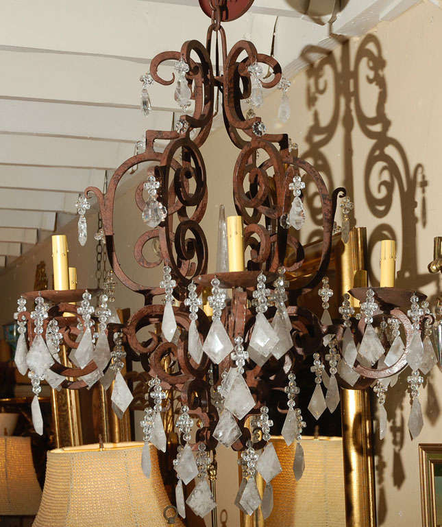 1980s wrought iron six-light chandelier cover with Brazilian rock crystal.