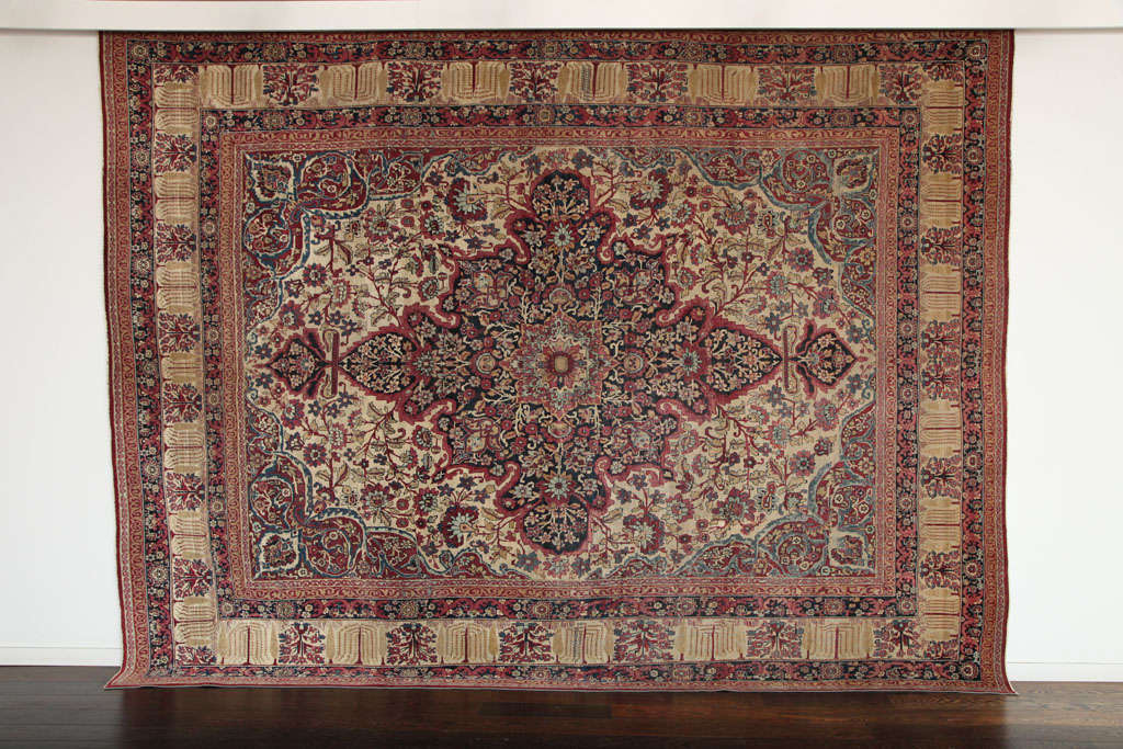 This Persian Kermanshah carpet circa 1880 consists of handspun wool and vegetable dyes. The size is 8'4
