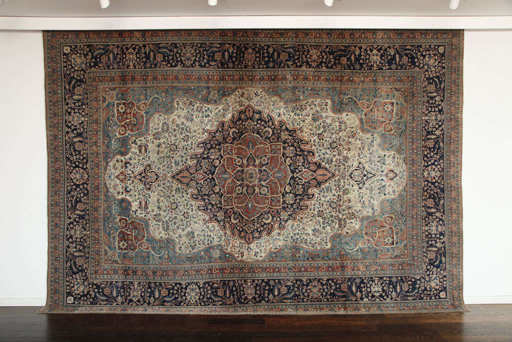 This Persian Kashan Mohtasham carpet circa 1870 is exceptionally fine and in excellent antique condition. It consists of a cotton warp and thread, hand-knotted wool pile and natural vegetable dyes. Its intricate medallion, field and border are