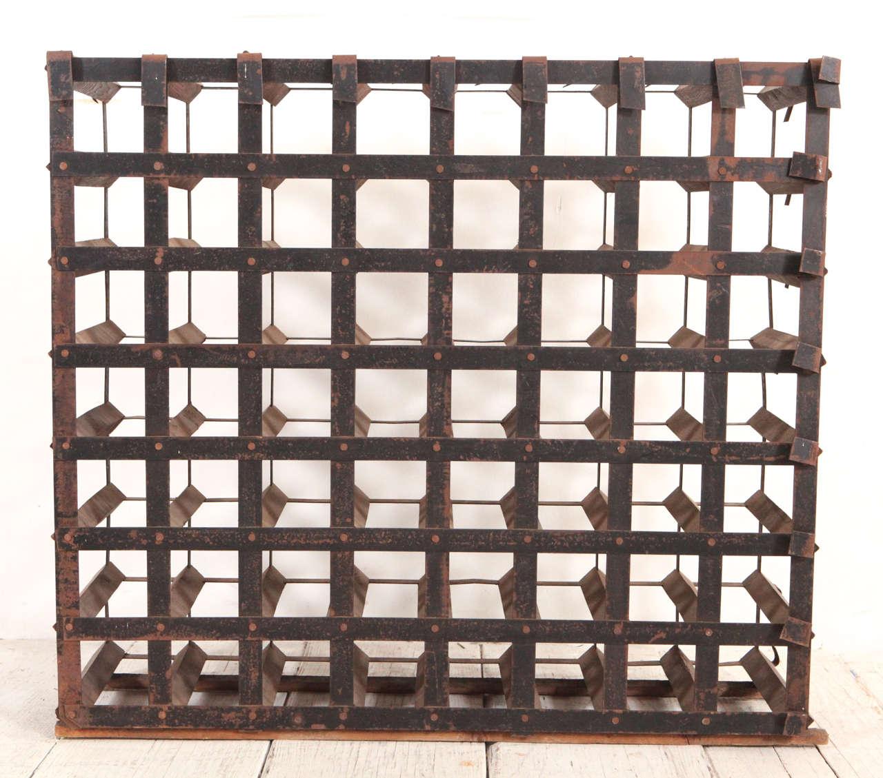 Rustic iron metal bottle rack. Holds 56 bottles.