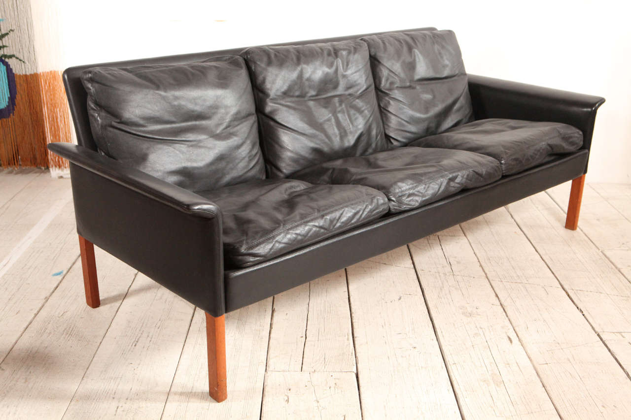 Soft black leather sofa attributed to Hans Olsen.
