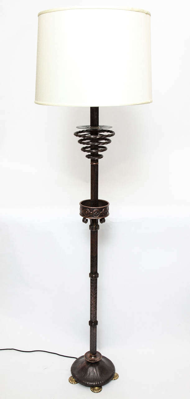 A 1920s Art Deco patinated bronze floor lamp. Shade not included