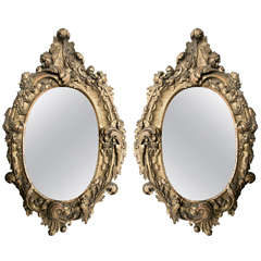 Pair of Oval Rococo Style Giltwood Mirrors