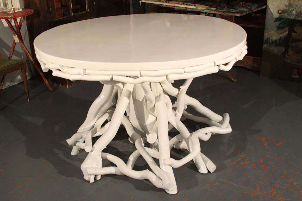 Chic Twig-Style Center Table in a high-gloss creamy white lacquer finish.  A subtle way to bring an outdoor or organic form into any modern setting, this is perfect with a holiday display, a serving table for parties, an office or foyer piece, etc.