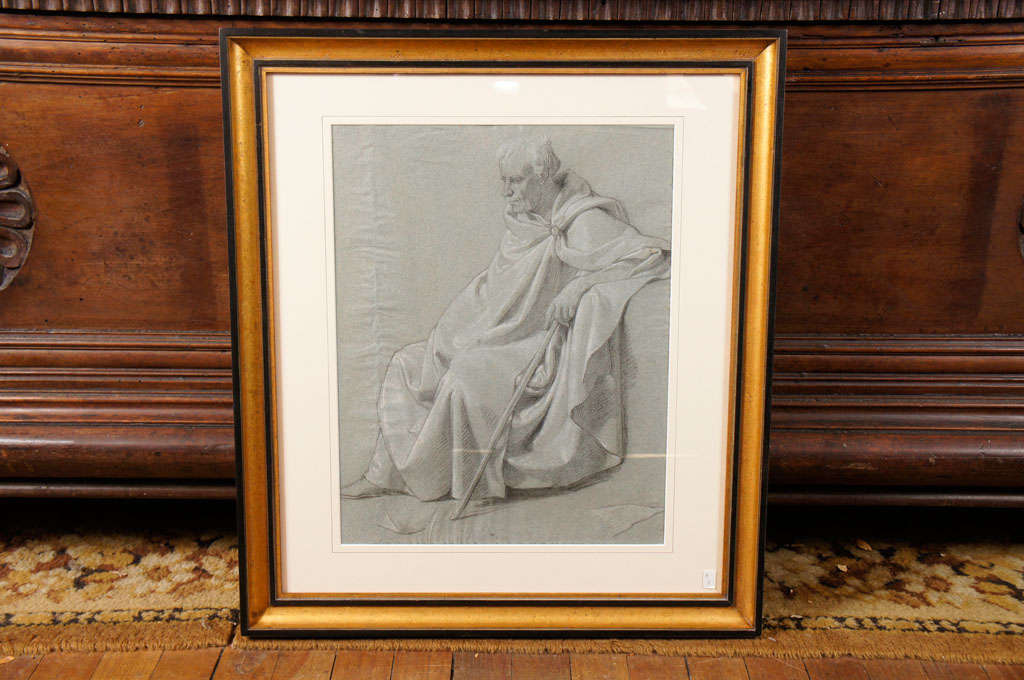 This beautiful and sensitive drawing is done on hand made blue paper and is highlighted with white chalk. The work done as a study for a large allegorical painting is typical of the works from the time using neoclassical elements to tell a current