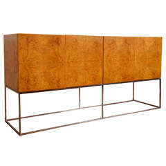 Burl and chrome floating  sideboard by Milo Baughman