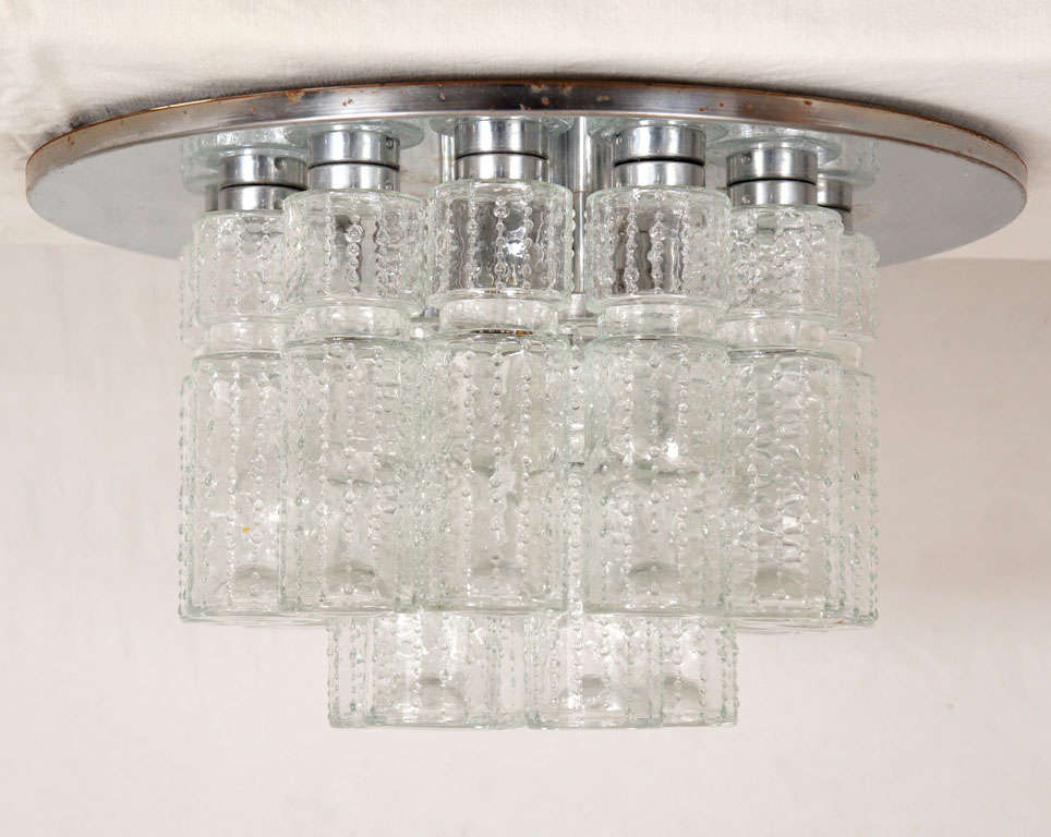 these lights are fantastic! They hung in a private woman's powder lounge in the Henry Ford building in Michigan. They were a custom design by lightolier. All glass is perfect, with a few extra cylinders for those OS moments. glass tubes surround