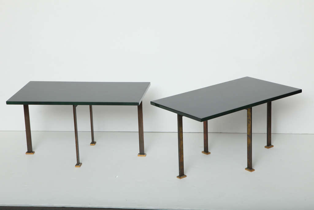 Unique pair of lacquered side tables with patinated and gilt bronze legs by Maison Leleu.