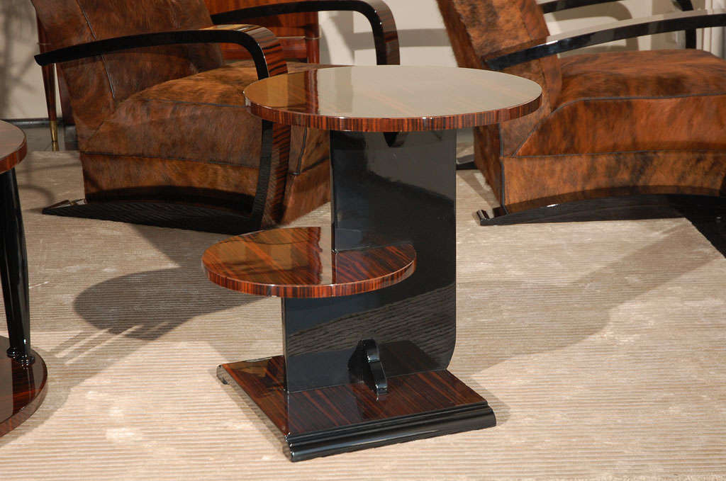 Modernist design side table. Beautiful Macassar table top with black lacquer center body. Stepped, 2-tiered tops for additional space.