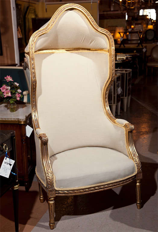 Pair of French Porter's chairs, each has beautiful gilded frame, hooded top, newly upholstered in linen, no cushions. Raised on fluted legs.