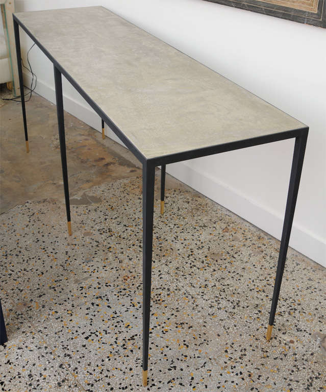 Exquisite long iron console with polished marble top.