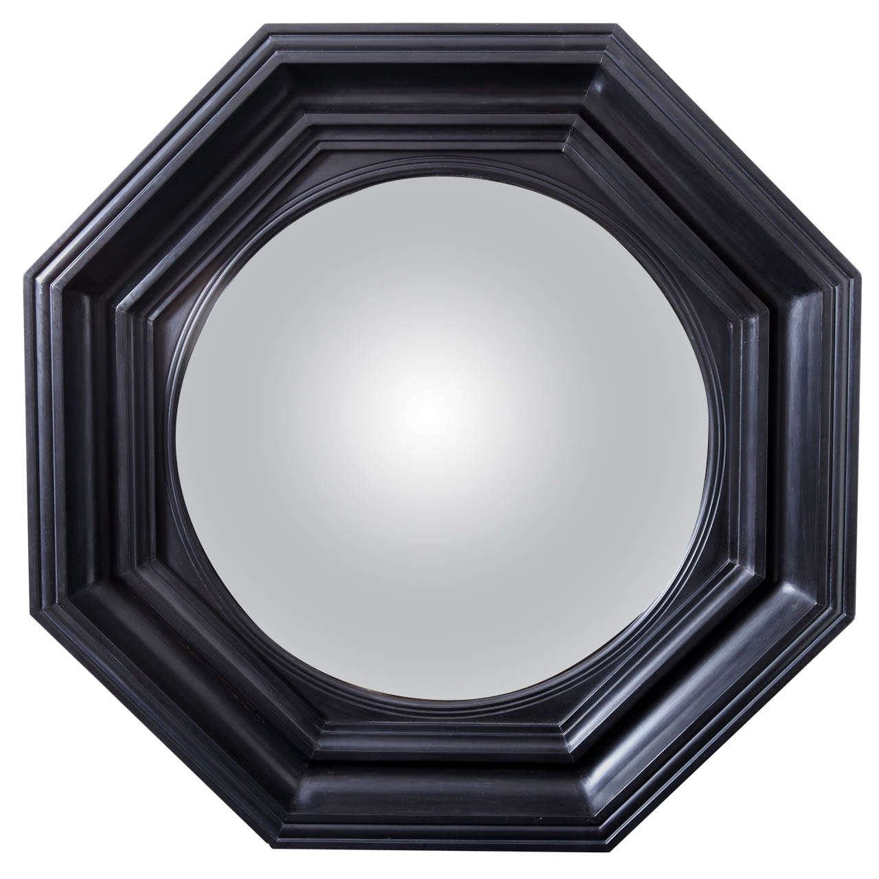 Regency style carved wood and ebonized convex mirror