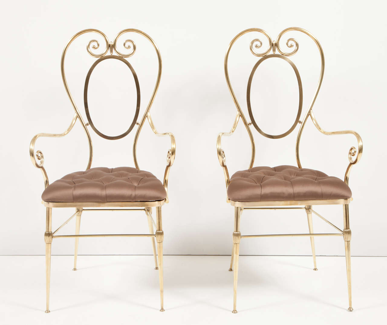 Decorative pair of brass side chairs, Italy, circa 1950. Upholstery in silk fabric, diamond tufting. Measures: Seat height is 18 inches.