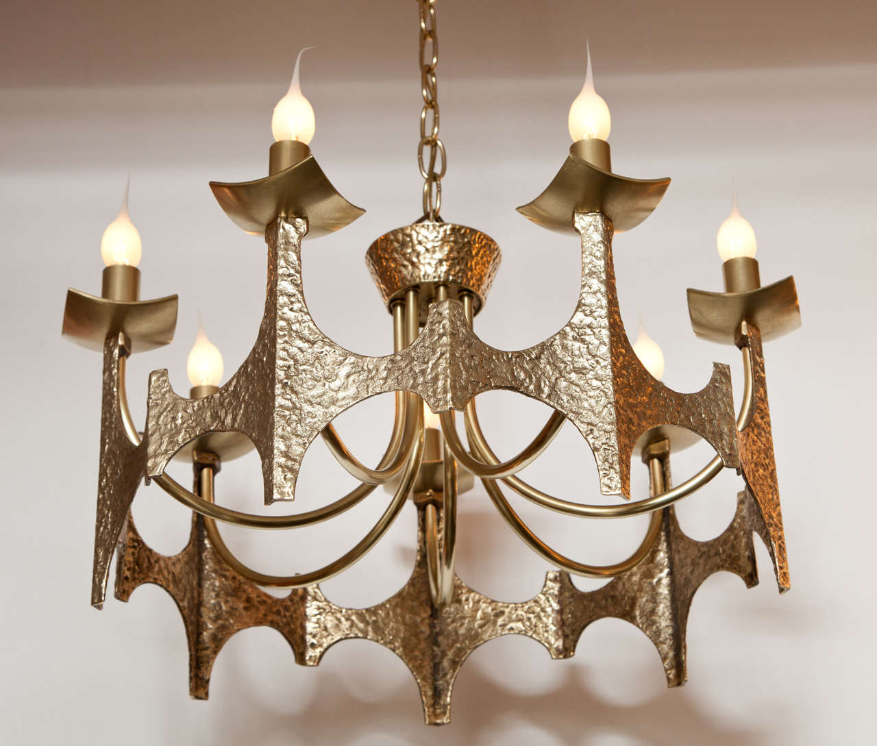 Decorative Brutalist brass chandelier, circa 1950.