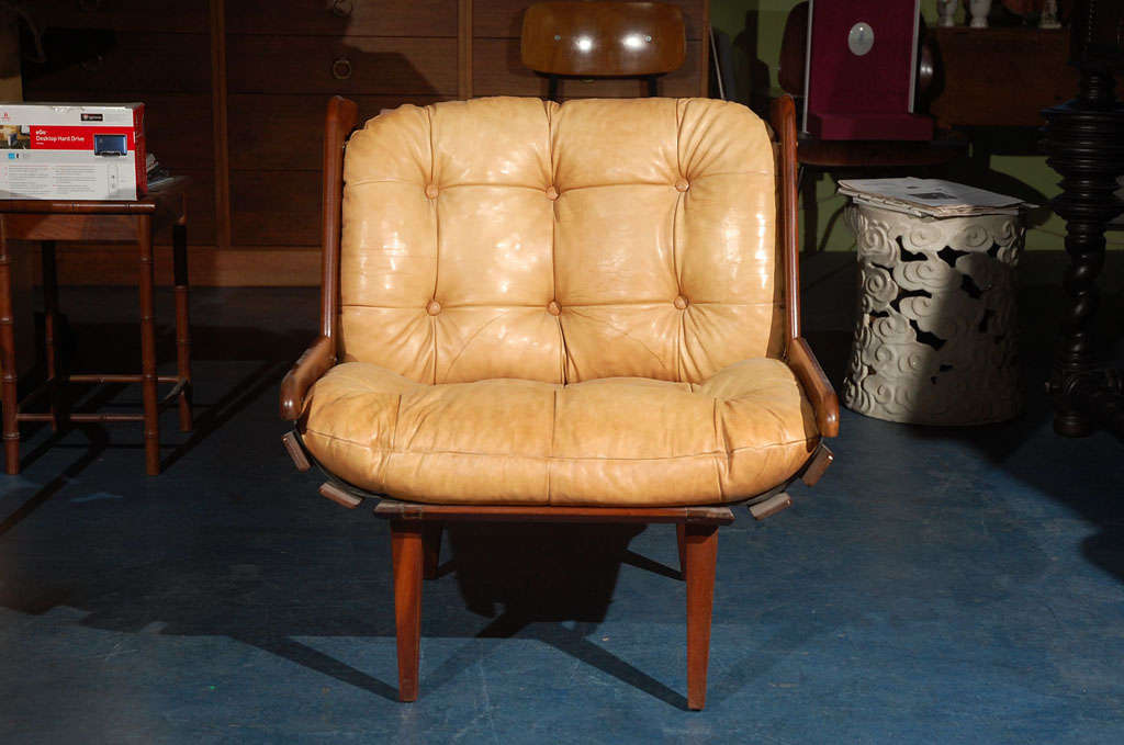 Brazilian low leather and rosewood armchair.