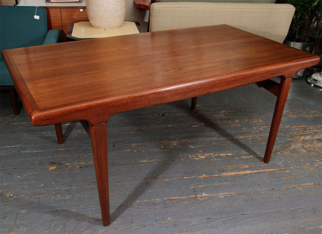 "Handsome and sculptured, Danish teak dining table with 2 extensions of 26.75"" each. Nicely detailed."
