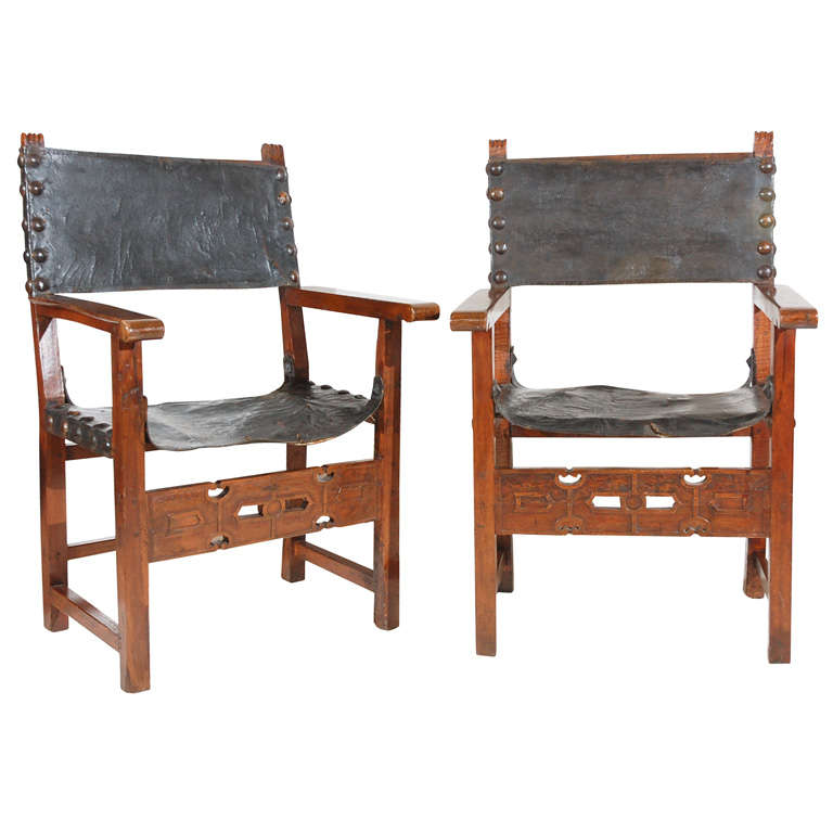 Pair Of Spanish Colonial Leather And Carved Oak Open Arm