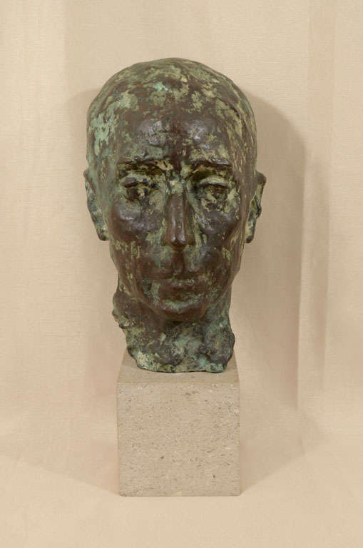 Green patinated cast bronze bust of a man by sculptor Sydney Harpley. Wonderfully detailed and interesting this sculpture feels very substantial. Mounted on a square plinth of Portland stone. The base measures 5