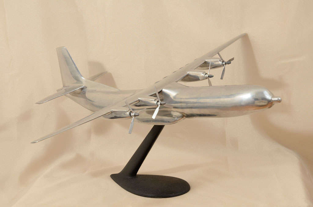 This large aluminum model is a replica of a Douglas C-133 Cargomaster. The C-133 was a large cargo aircraft built between 1956 and 1961 by the Douglas Aircraft Company for use with the United States Air Force. It was the USAF's only production