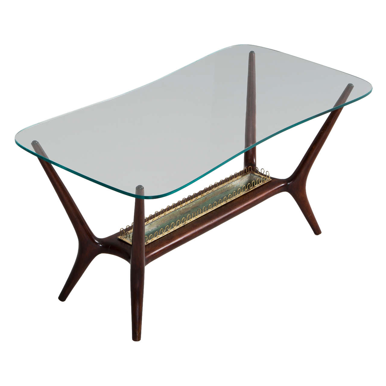 Italian cocktail table with curved glass top