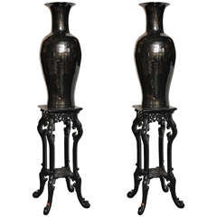 Pair of Decorative Black Chinese Style Porcelain Vases on Lacquered Pedestals