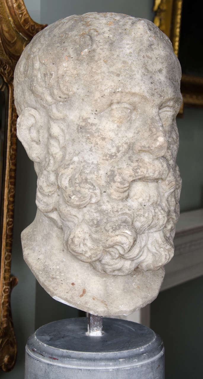 Th century carved limestone bust of solon for sale at
