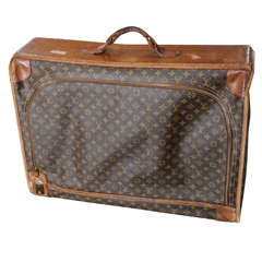 A vintage Louis Vuitton monogram leather suitcase / luggage